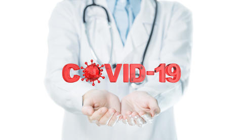 Covid-19 text on doctor's hand for stop the spread of coronavirus concept Photo
