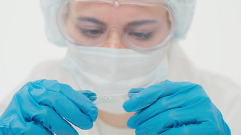 Close-up of a blurred young employee of a large research laboratory Live Action