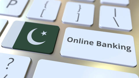 Online Banking text and flag of Pakistan on the keyboard. Internet finance Live Action