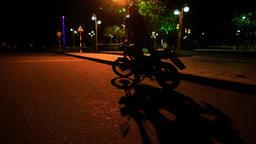 Guy in Helmet Mounts Motorcycle in Street Darkness Live Action