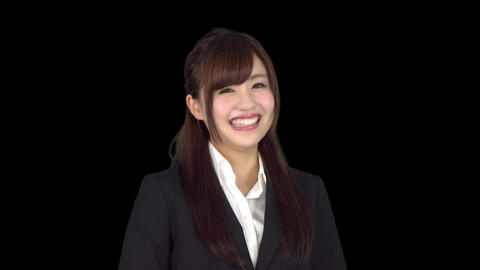 Young Japanese business woman smiling Live Action