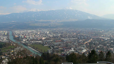 Aerial view of big city, river, Austrian Alps, mountain ridge Footage