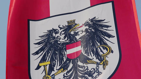 Austrian flag with coat of arms, national emblem waving in wind Footage