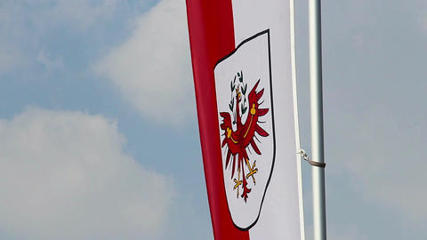 Flag with Tyrol coat of arms, popular Austrian tourism center Footage