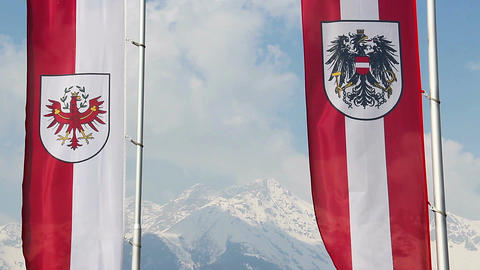 Tyrol, Austrian flags waving, majestic snowy Alps on background Footage