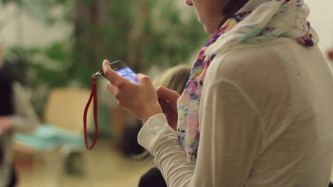 Girl selecting, using mobile applications on smart phone, gadget Footage