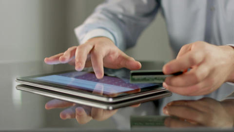 Male hands booking tickets, paying bill online on tablet PC Footage