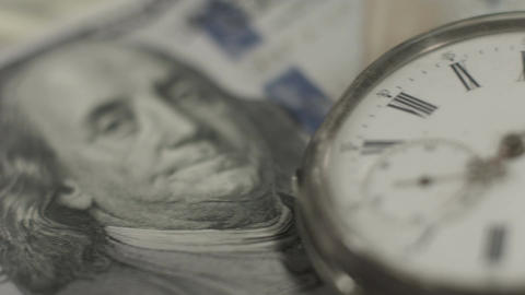 Time, money. Watch, one hundred dollar bill closeup. World bank Footage