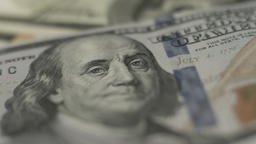 Counterfeit money detection, new one hundred dollar bill closeup Footage