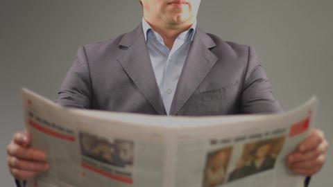Businessman reading newspaper. Finances, politics, stock market Footage