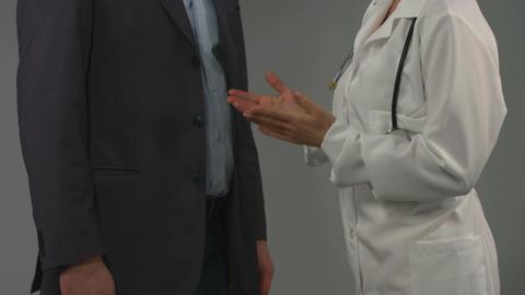 Woman doctor consulting patient. Diagnosis, prescription, advice Footage