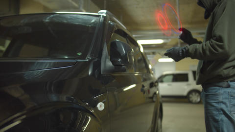 Steal car at parking with futuristic tablet decision. use interactive interface Live Action