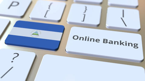 Online Banking text and flag of Nicaragua on the keyboard. Internet finance Live Action