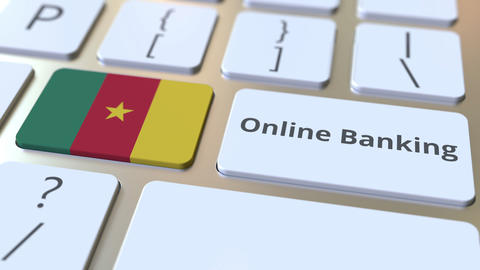 Online Banking text and flag of Cameroon on the keyboard. Internet finance Live Action