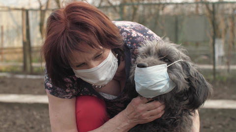 Woman with dog in protective masks Live Action