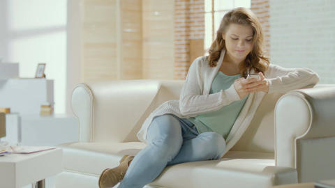 Happy young smiling female chatting with boyfriend on smartphone Footage