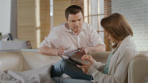 Couple actively discussing family business problems, focus out Footage