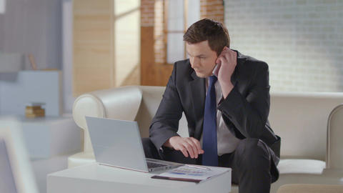 Businessman dialing number, making business phone call in office Footage