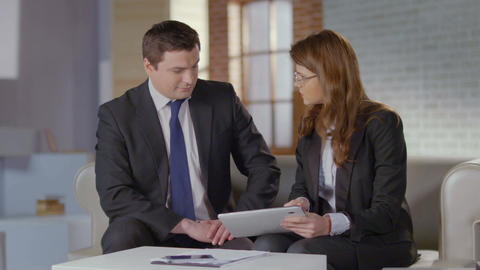 Female employee showing financial charts, presentation to boss Footage