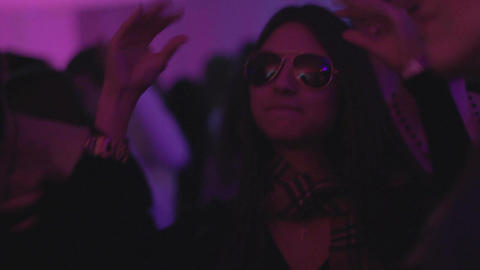 Sexy brunette hanging out at nightclub, enjoying disco, hands up Live Action