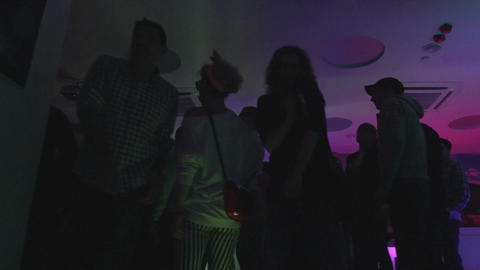 Young men, women enjoying music, having drinks, relaxing in club Footage