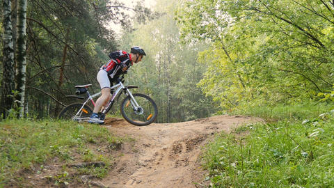 Cyclist rides through the forest Footage