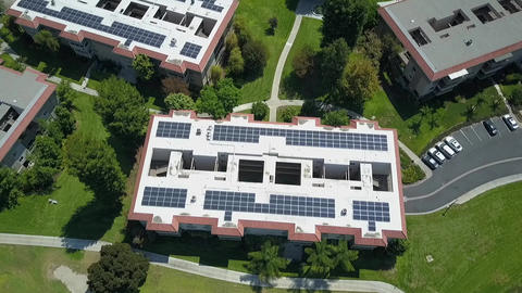 Huge complex of retired community, aerial solar panels clean energy, in Laguna Live Action