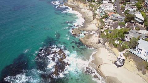 Victoria beach, aerial birds eye view, coastal houses along shoreline, Laguna Live Action