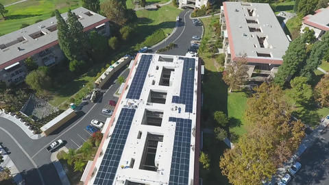 Aerial, Installation of Solar Panels on Retirement Building, renewable Energy Live Action