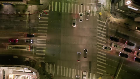 AERIAL HYPER LAPSE: Road Intersection at Night with Car Traffic and City Lights Live Action