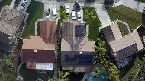 Rising birds eye aerial, solar panels, Renewable energy, residential home Live Action