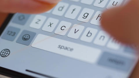 Hands typing text on smartphone close-up Live Action