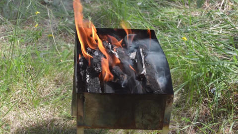 Burning Wood An Coals In Rusty Portable Outdoor Bbq Grill In Sunny Day Live Action