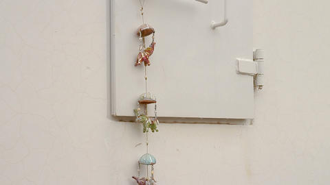 Decoration hanging on a window of a mobile bomb shelter in Israel Live Action