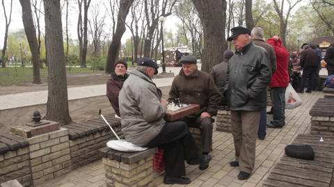 Pensioners play chess in the park in the fall autumn . Kyiv, Ukraine Live Action