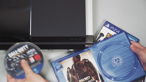 Selecting PlayStation 4 game to play top view Live Action