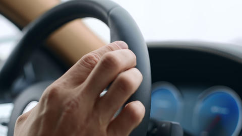 Male hand knocking fingers on steering wheel. Man putting fingers on wheel Live Action