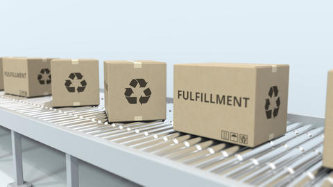 Many cartons with FULFILLMENT text move on roller conveyor. E-commerce logistics Live Action