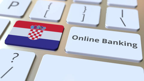 Online Banking text and flag of Croatia on the keyboard. Internet finance Live Action