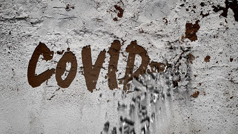 """On the white, battered concrete wall appears the inscription:"""" COVID-19 """" concrete crumbles into Animation"""