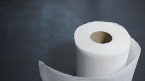 A roll of toilet paper slowly falls onto the table. Toilet paper shortages Live Action