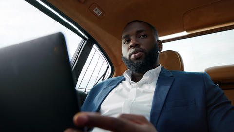 Closeup african man talking video call at car. Man talking to driver at vehicle Live Action