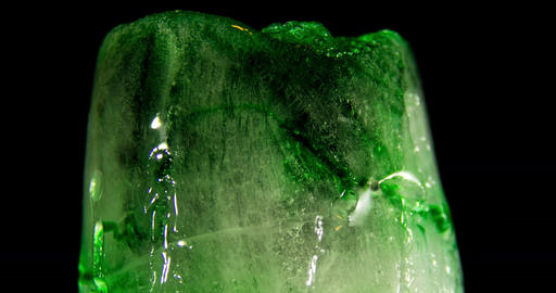 Timelapse of green Ice glass melting, on black background ビデオ