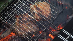 Grilled meat on the flaming grill Footage