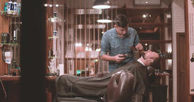 Hairdressing process at barbershop 4k video. Barber cutting beard with clipper Footage