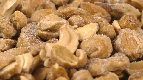 Close-up of mixed nuts on a rotating plate Footage