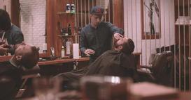 Barbers works lumberjack barbershop 4k video. Vintage interior: whisky Footage