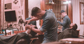 Hairdressing process vintage barbershop 4k video. Barbers working lumberjack Footage