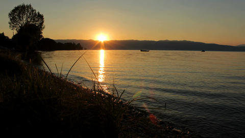 Timelapse video 4K boat on Ohrid lake with sunset Footage