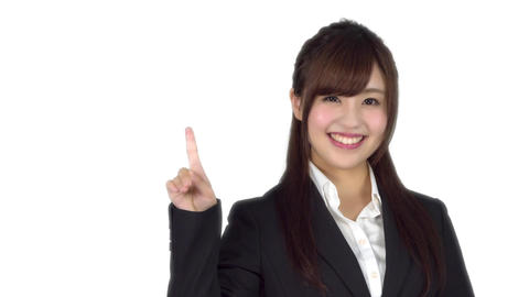 Young Japanese business woman points Live Action